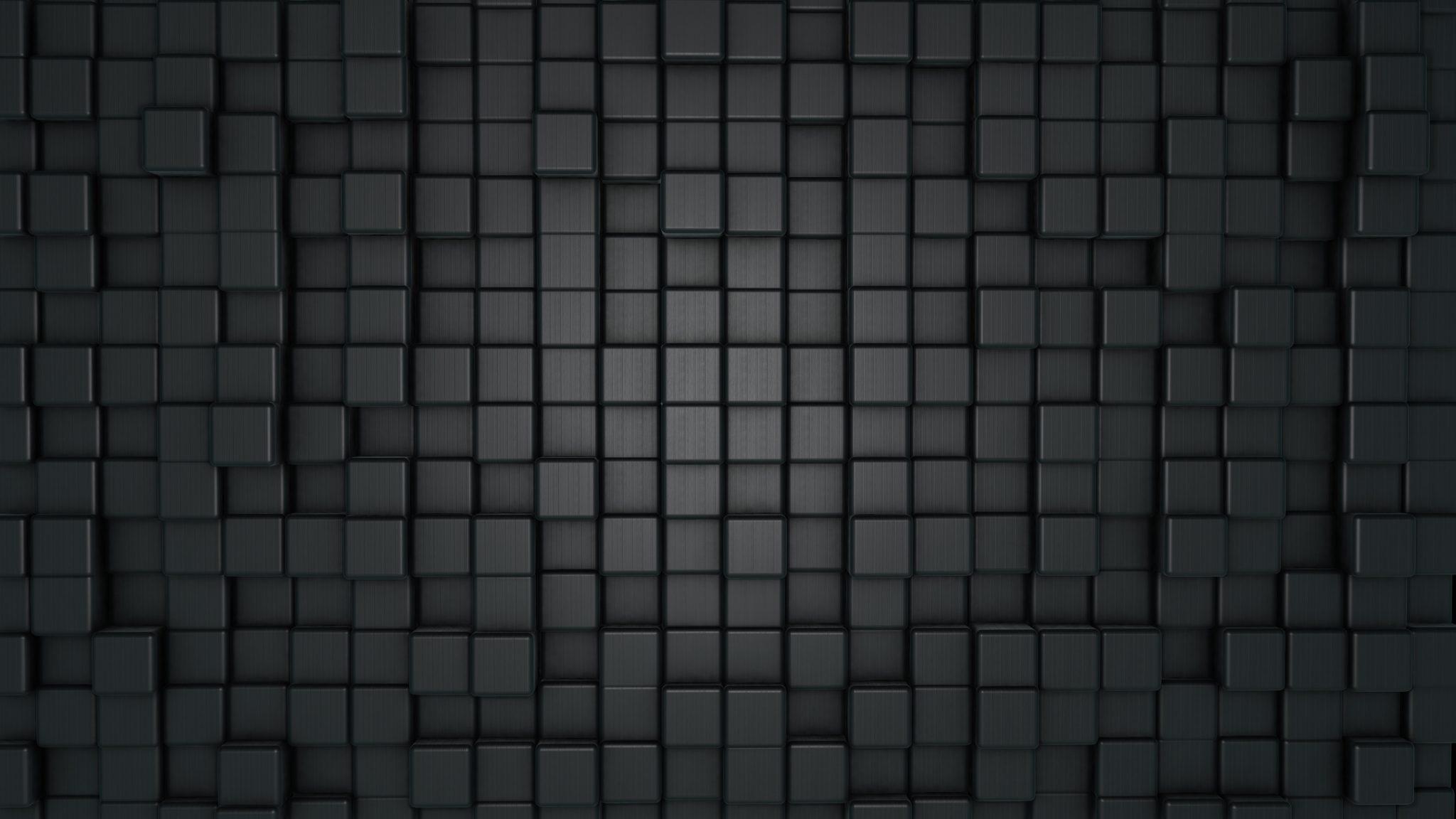Dunkelgraue Würfel aus mattem Material unsauber angeordnet